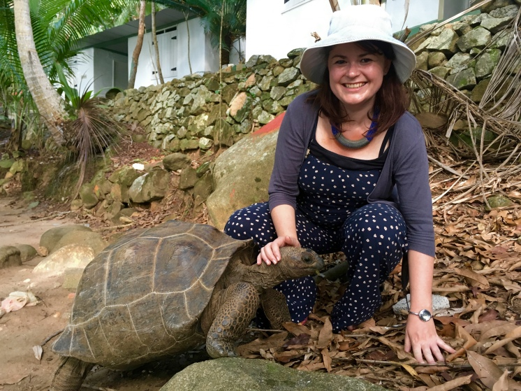 Shannon with a giant tortoise in the Seychelles