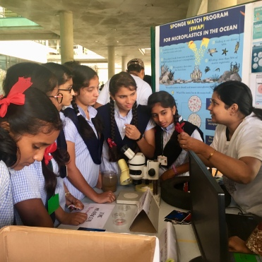 Anshika showing how microplastics are produced